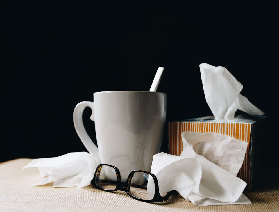 A mug of soup and a box of tissues for an allergy sufferer.